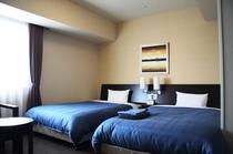 コンフォートツインルーム〜20平米12階〜14階。落ち着いた家具の色調でワンランク上の快適さを