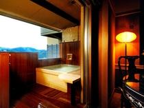 バリアフリー ツインベッドルーム【琥珀】(※室内風呂なし)の源泉掛け流し露天風呂。