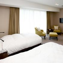 プレミアムスイートのベッドルーム。ゆったり快適な睡眠をお約束いたします。
