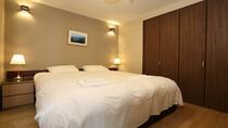 1ベッドルームアパートメントと2ベッドルームアパートメントの寝室