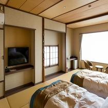落ち着く和室にシモンズベッドを2台ご用意しております。