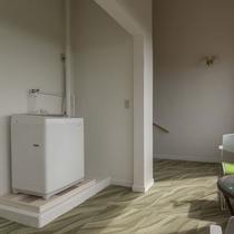 3階踊り場に無料の洗濯機を設置