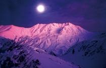夕日に照らされる立山