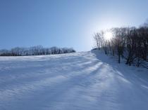 峰の原高原スキー場と朝日