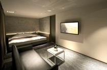 313号室『洗い出し』/洗い出しの壁面がベッドを包み込む。