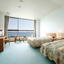<客室一例>洋室。イルカの住む有明海を望む、全室オーシャンフロントの客室。