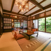 *【客室一例(2階すずらん)】窓の外には川のせせらぎと四季の美しさが広がります。