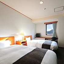 スタンダードツイン【2014年9月◆全室リニューアル】洋室のベッドは≪デュベスタイル≫に変わりました