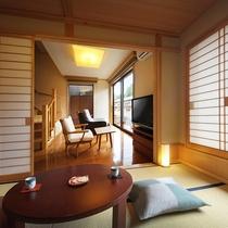 【風の音・客室】水盤に面したリビング和室6帖。1階・2階ともトイレがございます