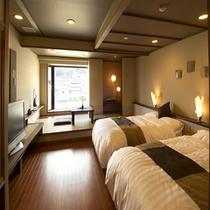 「コンフォート客室」ツイン。お布団よりベッドがお好きな方にオススメ!窓際には掘り炬燵も♪