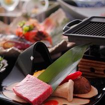 鉄板で焼くステーキ