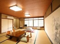 【松の間】和室15畳 冬期はこたつでお出迎えします。