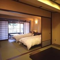 ツインベッドを備えた二間続きの和洋室