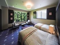 ベッドルームは洋室ツインルームで、クイーンサイズベッドをご用意。最上のくつろぎをお約束します。