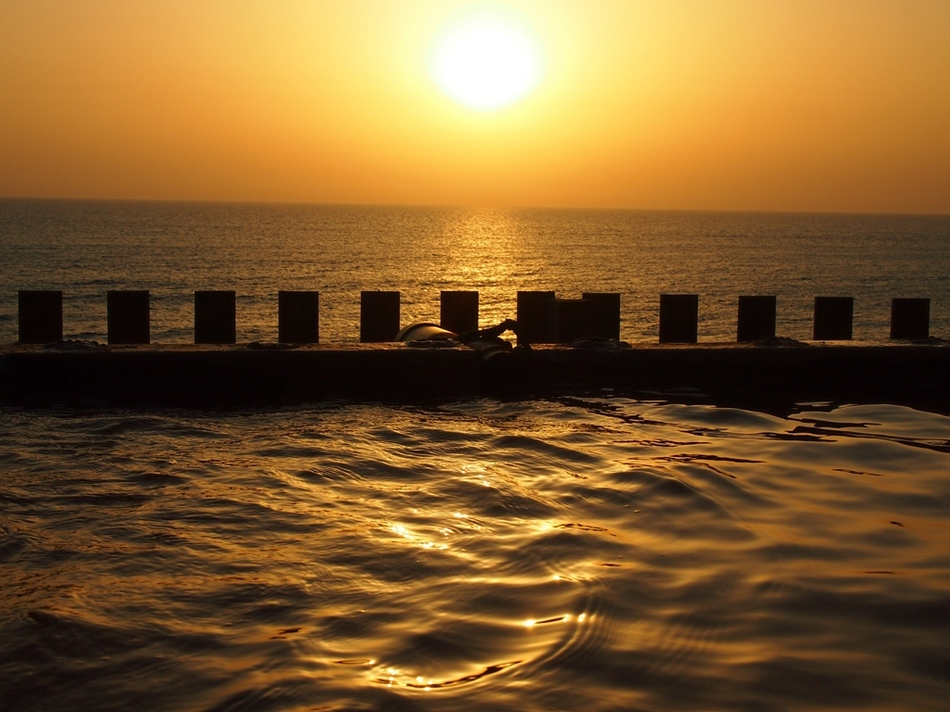美しい夕日を眺めながらの温泉は格別