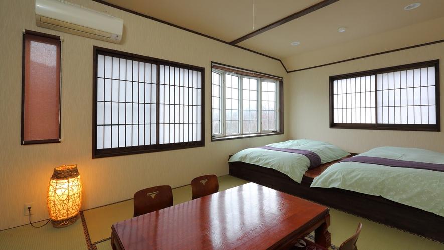 開放的な空間の中に8畳とローベッドタイプの和洋室