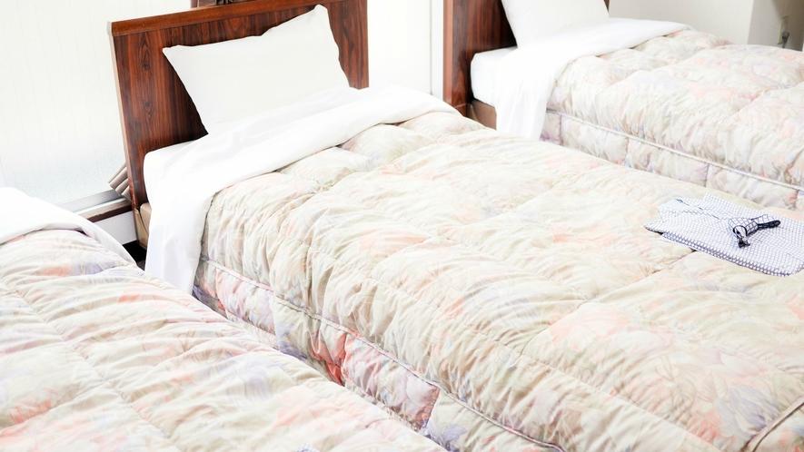 トリプルのお部屋:3ベッド配置のゆったりとしたお部屋。ご家族で・グループでお気軽にご利用下さい。