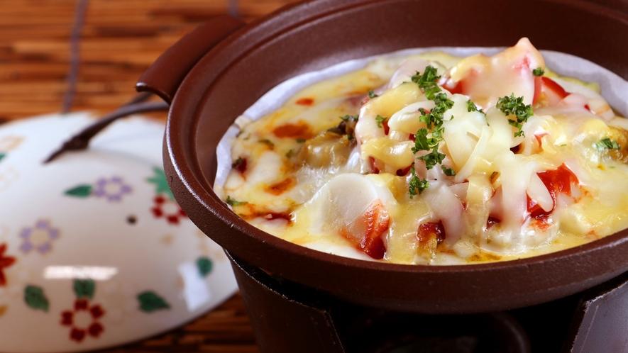 夕食一例_香味野菜のピザ風。七浦荘のオリジナル料理