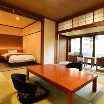 *客室一例/琉球畳調の和室とツインベッドを備えた露天風呂付き特別室
