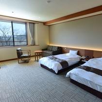 *客室一例/広々セミダブルベッドを採用したツインルーム