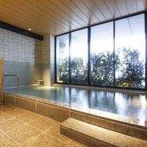 【大浴場】広々とした浴場でゆったりと疲れを 癒していただくことができます。