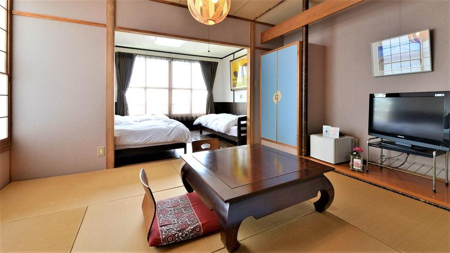 「和洋室」一例。2ベッドルームと和室でごゆっくりお寛ぎください