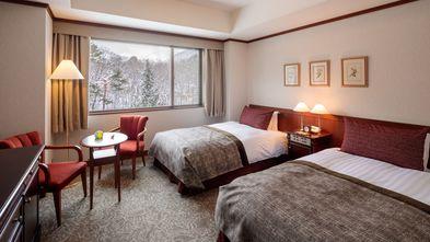 ◆エコノミーツインルーム一例(※正面玄関側のお部屋になりますが、画像は庭側です)