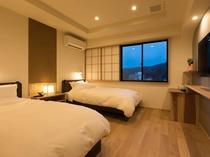 【半露天風呂付きスイートルーム】リクライニング機能付きのシモンズ製ベッドを設置