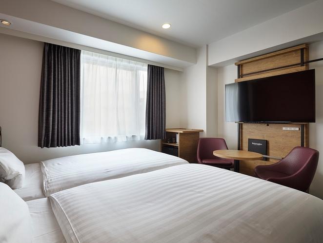 シングルベッドを2台並べて配置したハリウッドツインタイプ