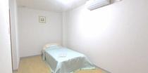 406号室ベッドルーム