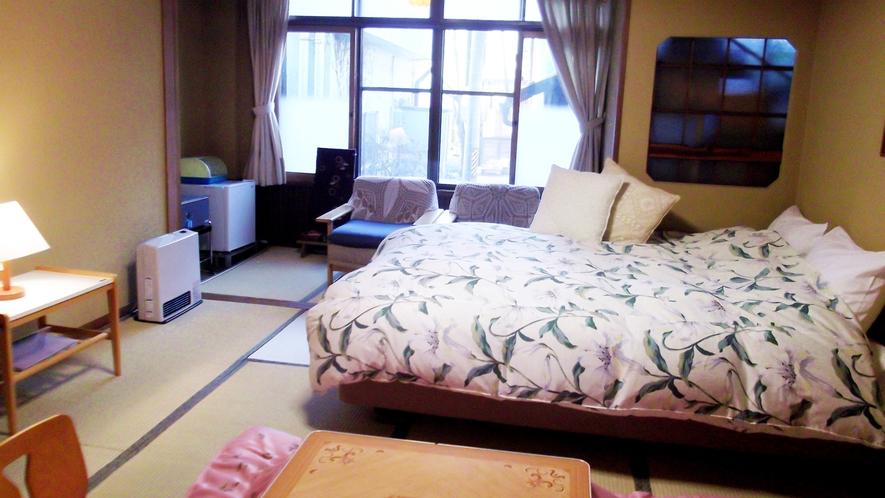 *部屋一例)ベッド付和室。