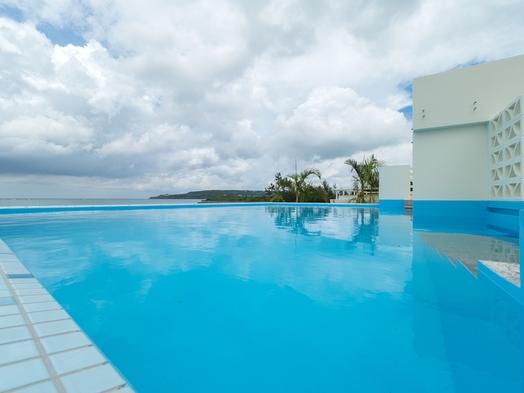 優雅に過ごす!静かな風を感じる広々デラックスルームでビーチを満喫!
