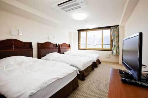 和洋室(ベッド2台+7畳)