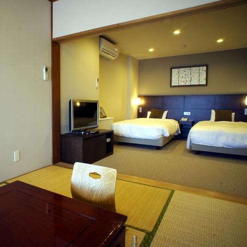 和洋室一例(和室6畳+ツイン)窓からは箱根の山々が一望できます。
