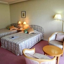 *ツインルーム一例。室内はやわらかな雰囲気の色調で統一しており、女性のお客様にもご好評です。