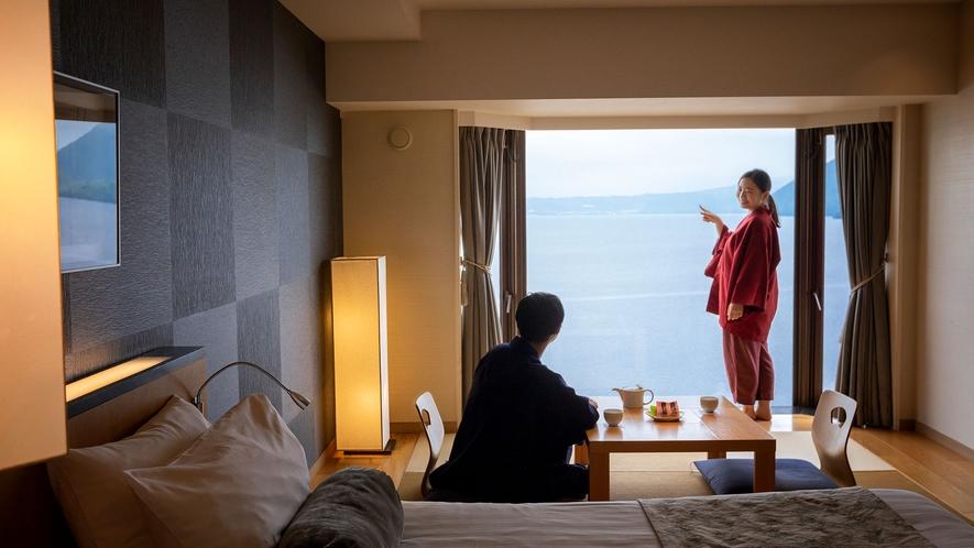 【スパリゾート館スタンダード和洋室】ベッド2台と琉球畳8畳のお部屋です。※滞在イメージ