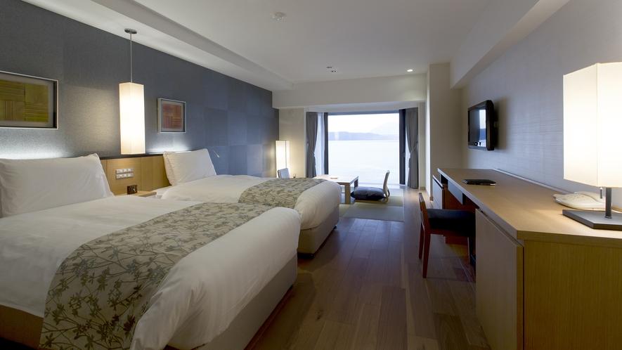 【スパリゾート館スタンダード和洋室】ベッド2台と琉球畳8畳のお部屋です。