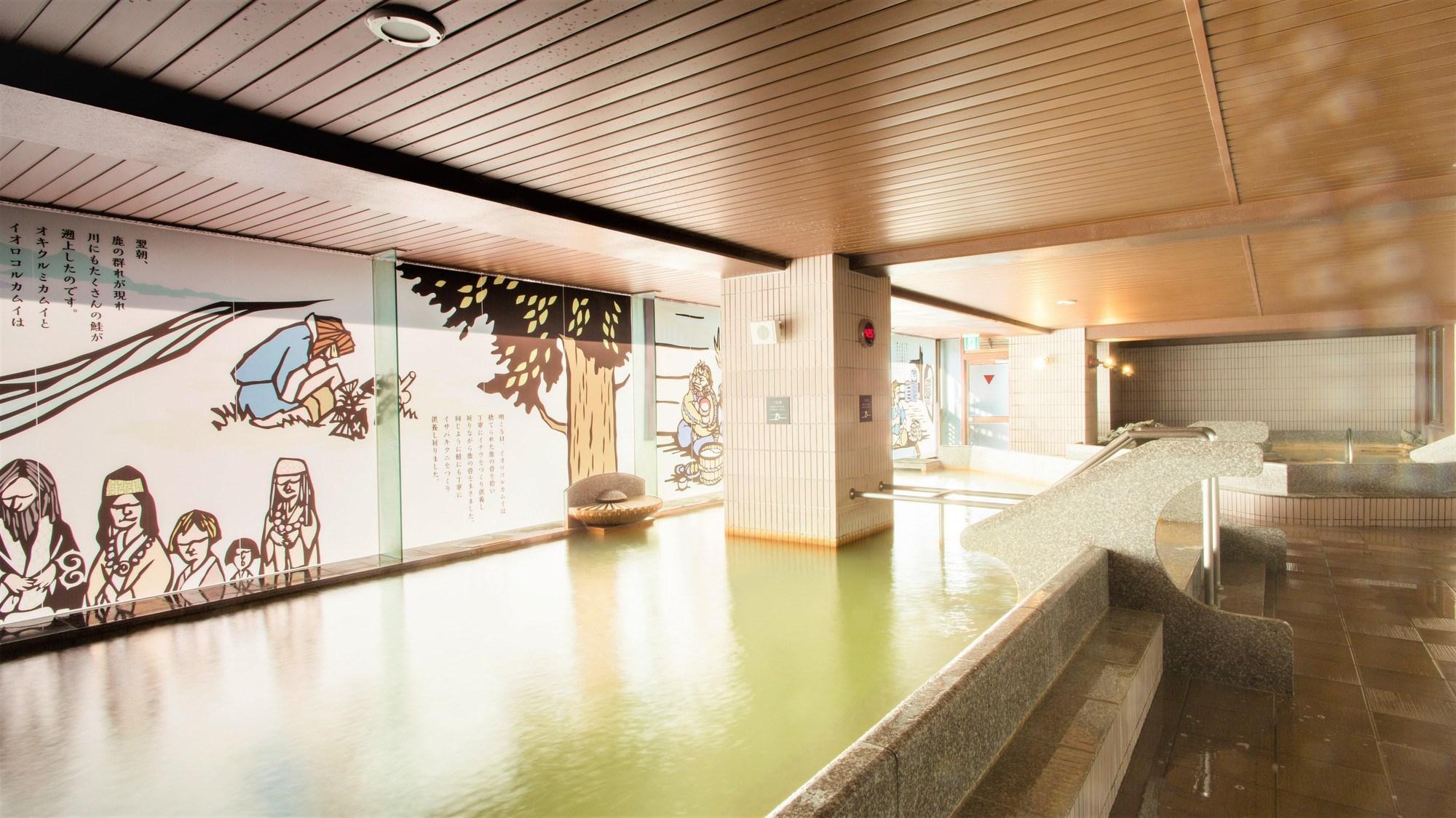【3F女性大浴場「マッネシリ」】壁に描かれたアイヌの物語を読みながら、湯浴みをお愉しみください。