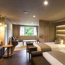【エグゼクティブルーム】ベッド2台を配し、畳スペースにもお布団を2組敷くことができます。