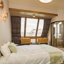 露天風呂付き客室、ベッドはシモンズならではの寝心地