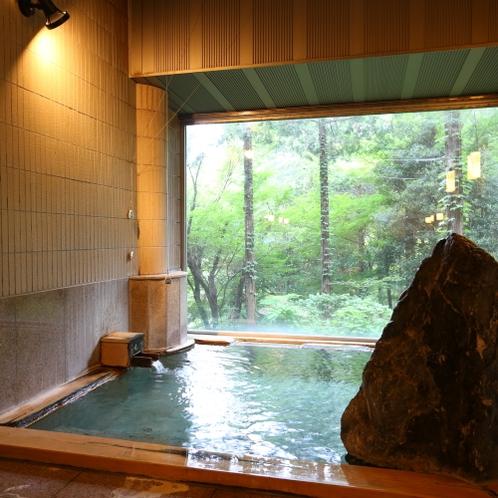 ■【女性風呂■真秀の湯】岩風呂を彷彿させる趣向の内装