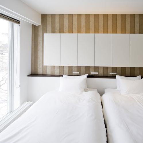 *1ベッドルームプレミアム室内一例/ツインまたはダブルベッドの寝室