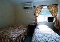 あみ本館洋室202号室のベッドルーム