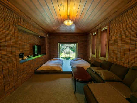 暖かみのあるレンガ造りの洋室1階 【ローベッドマットレス】