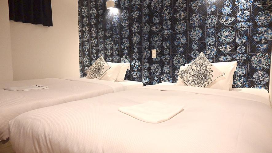 ・【ベッド広めツインルーム一例】セミダブルベッドを2台設置