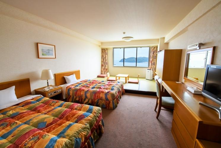 海側ファミリールームはツインベット+4・5畳付36平米。4名様まで寝具をご用意させていただけます。