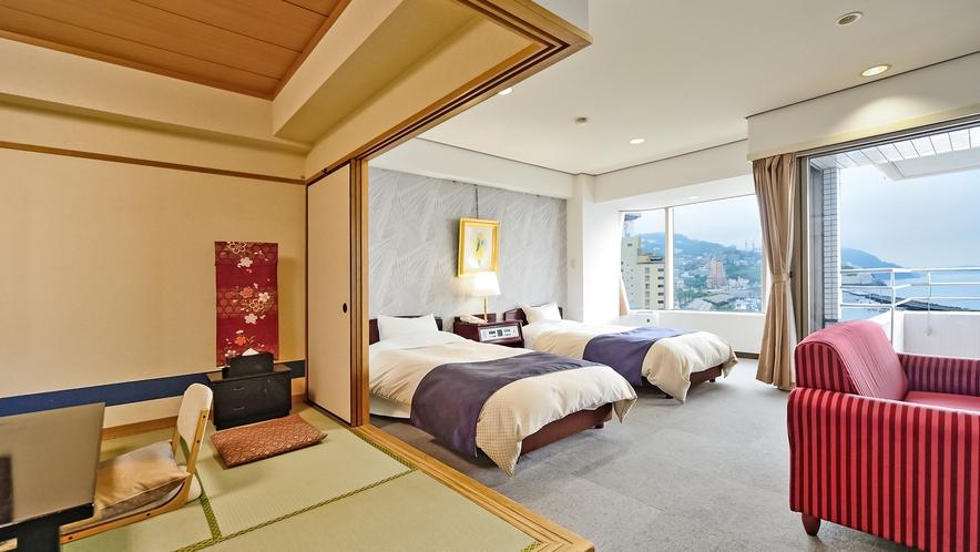 【和洋室 44平米】高層階のお部屋からは目の前に広がる相模湾や熱海の街並みが一望頂けます。