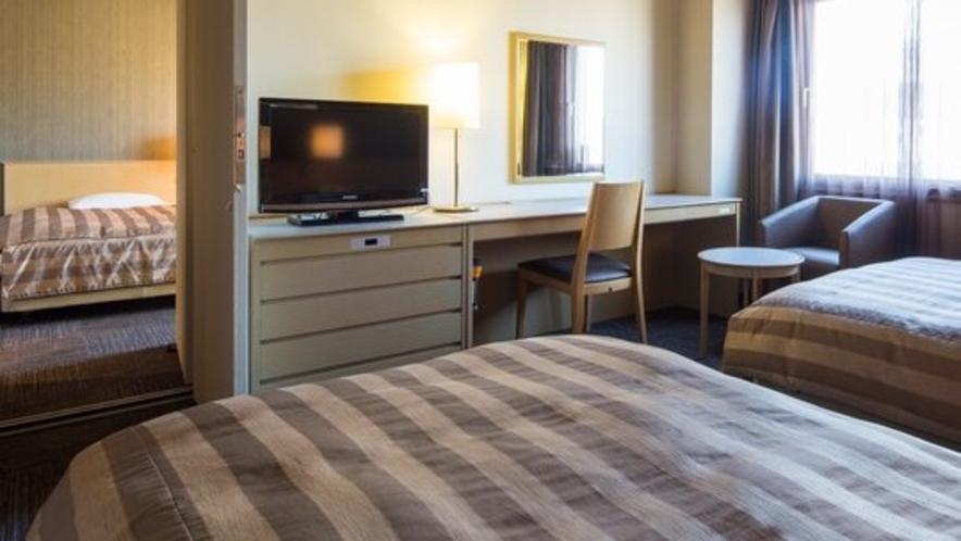 <コネクティングルーム>ツイン2室を中で行き来できるお部屋です。※ご予約はお電話にて承ります。