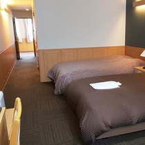 【スタンダードツイン】ベッドはセミダブルタイプでゆったりご利用いただけます。