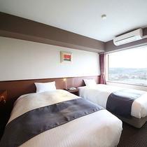 デラックス和洋室のベッドルーム